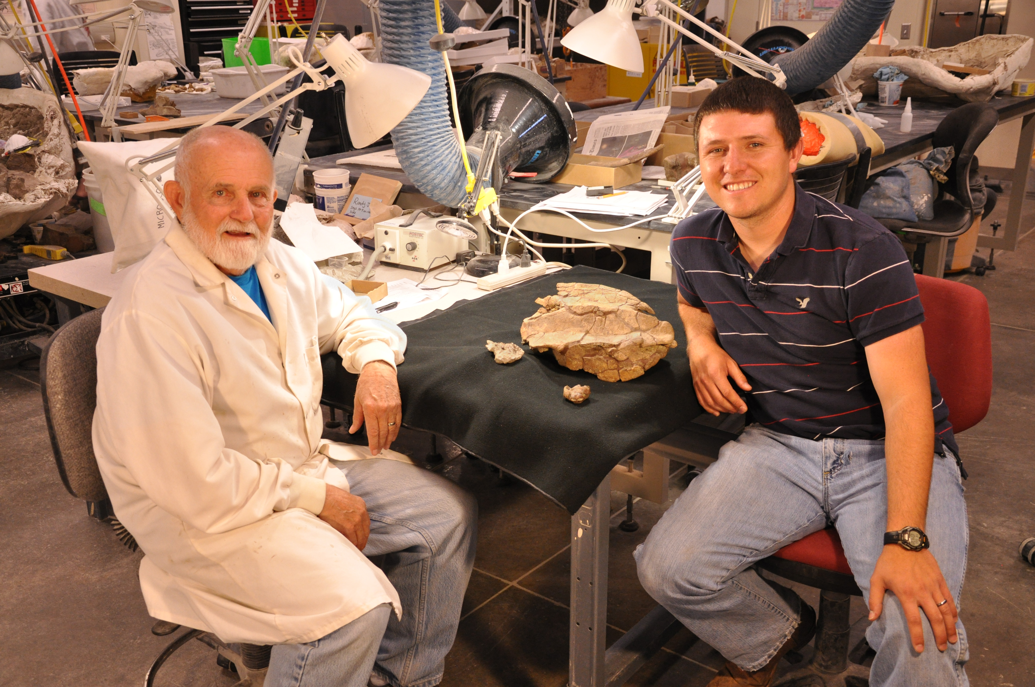 Researchers with pig-nose turtle fossil