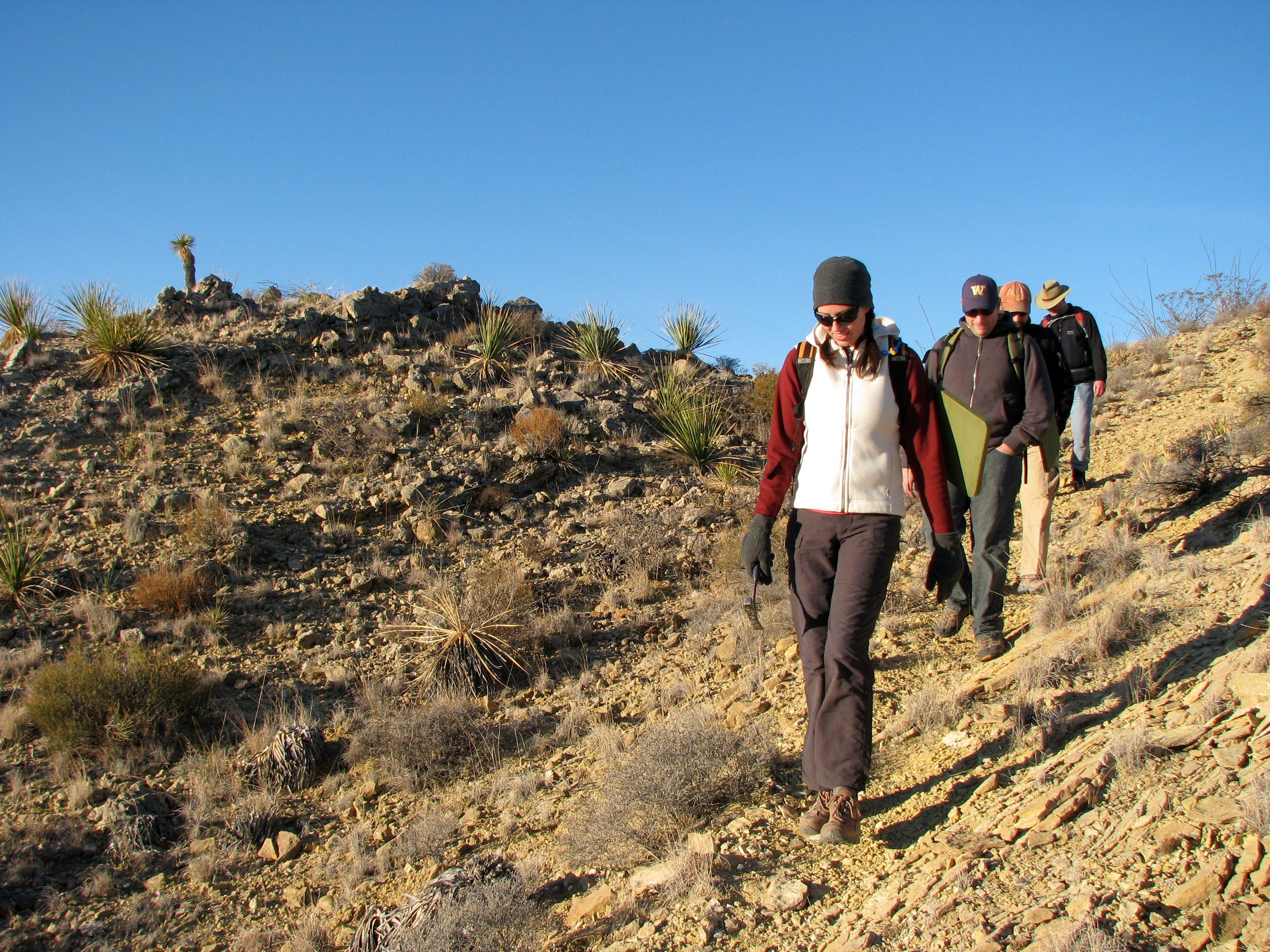 Michelle Stocker hiking to fossil dig site in West Texas.