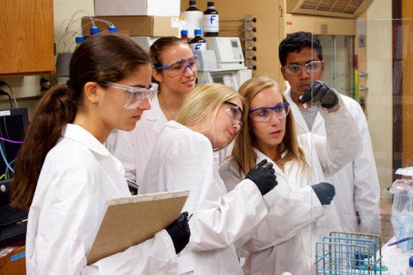 graduate-student-sarena-horava-helping-high-school-students-in-the-lab