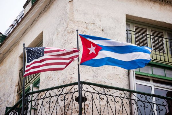 American and Cuban flags side by side