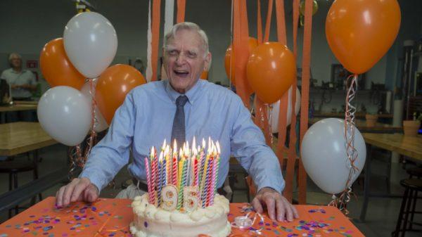 John B. Goodenough enjoying his 95th birthday cake