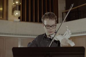 Riley performing with the final 3-D printed violin.