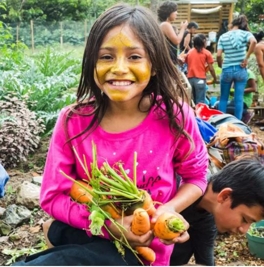 Girl gardening in Guatemala.