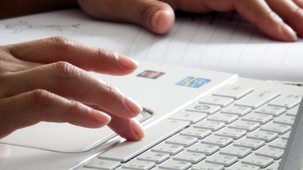 finger-pressing-computer-keyboard