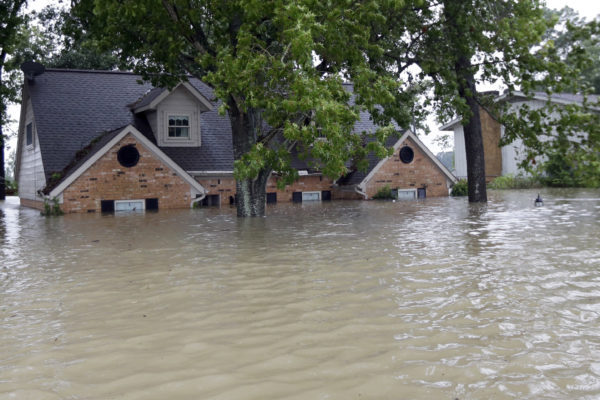 Home surrounded by floodwaters