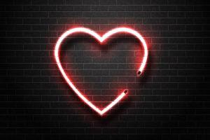 Faux neon Heart illuminated on brick wall