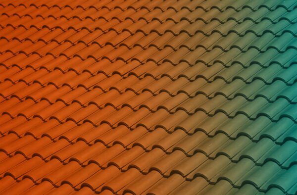 Orange and blue gradient on adobe roof tiles