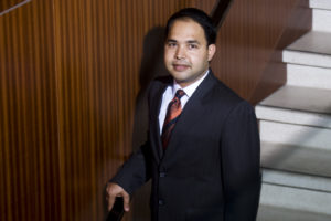 Energy Institute Executive Director Varun Rai pictured on staircase.
