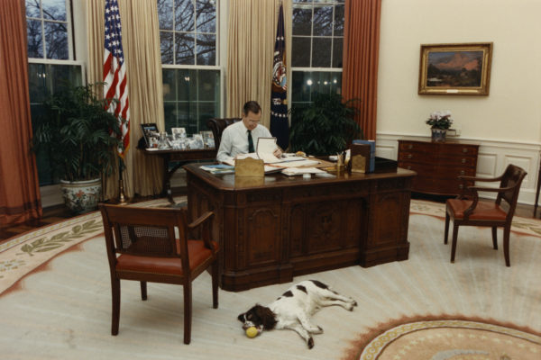 George H.W. Bush working at Oval Office Desk