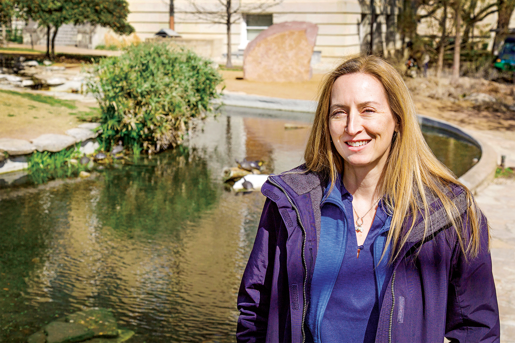 Carin Peterson stands by the UT turtle pond.