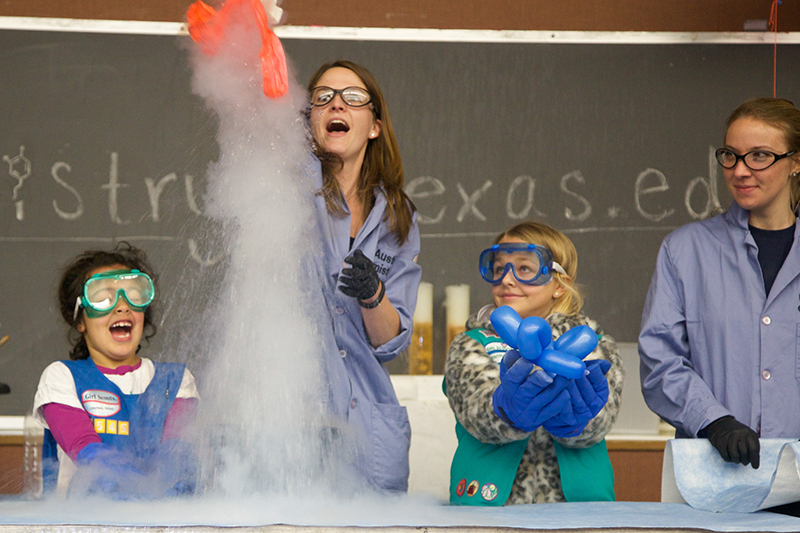 science experiment on stage at girl day event on ut austin campus
