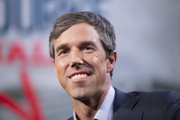 Beto O'Rourke smiling at a political rally