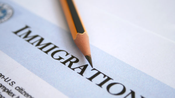 Immigration form with a pencil.