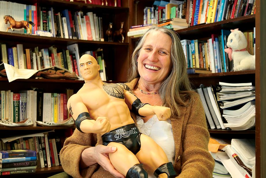 Janet Davis, holding a Rock figurine.