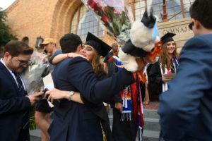 Hugging graduates.