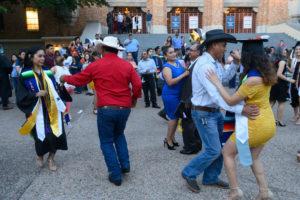 Families dancing at the LatinX graduation.