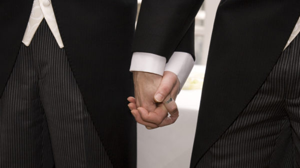 A same-sex couple holding hands