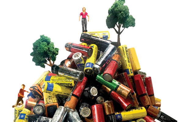 A pile of used batteries with small figures of people and trees.