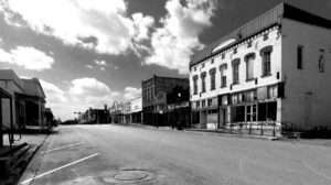 A black and white photo of the main street of a small town in Texas.