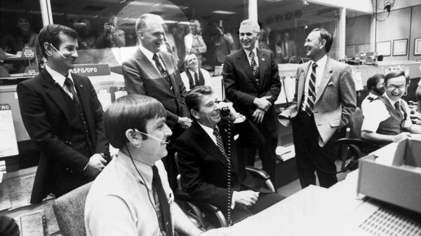 Hans Mark in mission control with President Reagan.