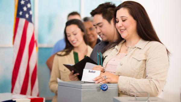 Women voting at ballot box