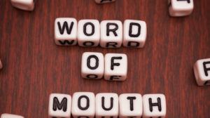 Close-up of word of mouth spelled out by beads