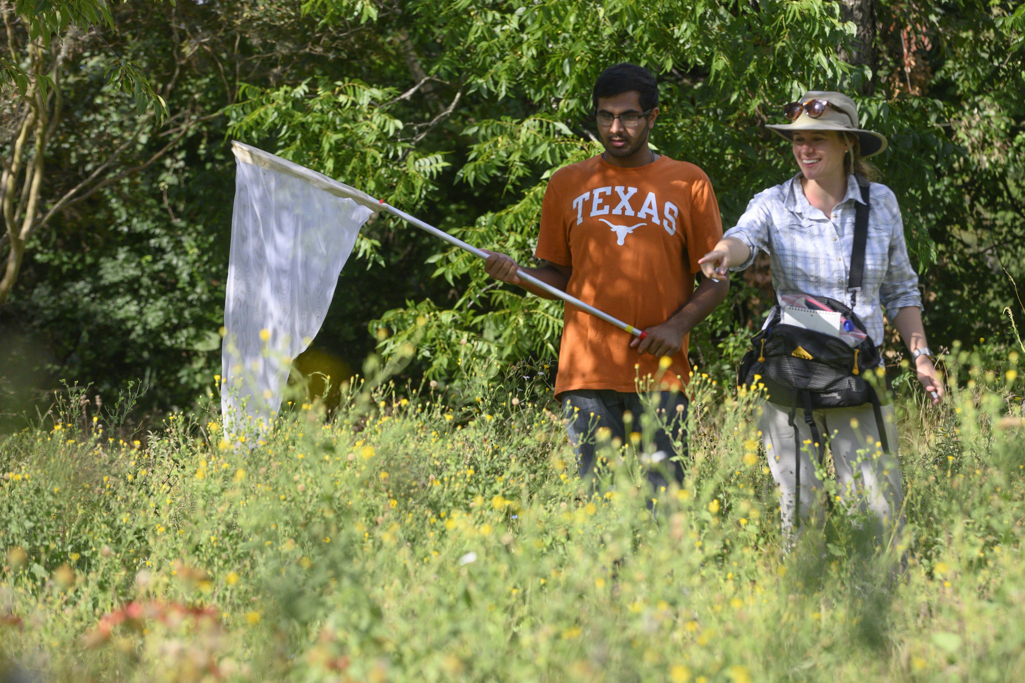 Freshman Research Initiatives pollinators 2019 The student is entering sophomore Sahran Hashim, shown here working with Professor Susan Cameron Devitt, at a site along Lady Bird Lake, west of Lamar Blvd. The student has a model release on file in University Communications for this story and any future, non-commercial use by UT.