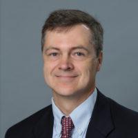 Headshot of LBJ School researcher Todd Olmstead