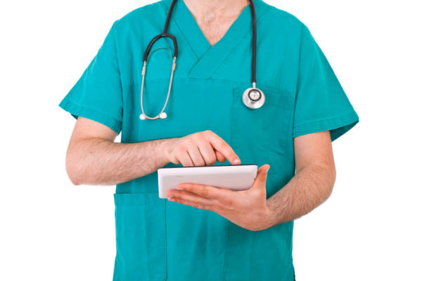 A medical doctor in teal scrubs
