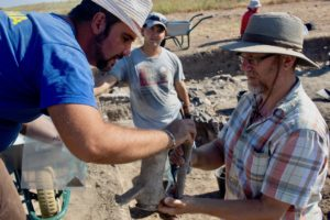 Associate Professor Rabinowitz and colleague examine Roman artifact.
