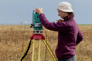 Student operates a surveying device