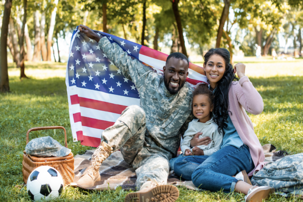 Military family with U.S. flag.