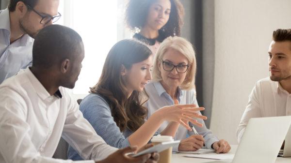 Female mentor leader coach teaching employees group