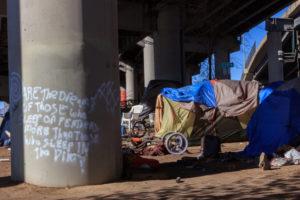 Homelss camp under a bridge
