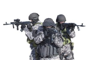 Three military members holding guns
