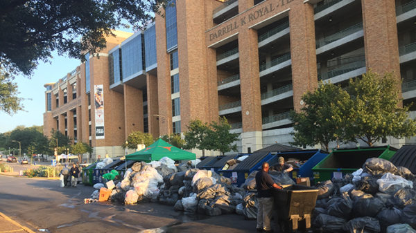 A photo of bags of trash and sorting bins outside Darrell K Royal - Texas Memorial Stadium.