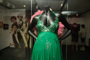 A photo of a green dress decorated with sequins.