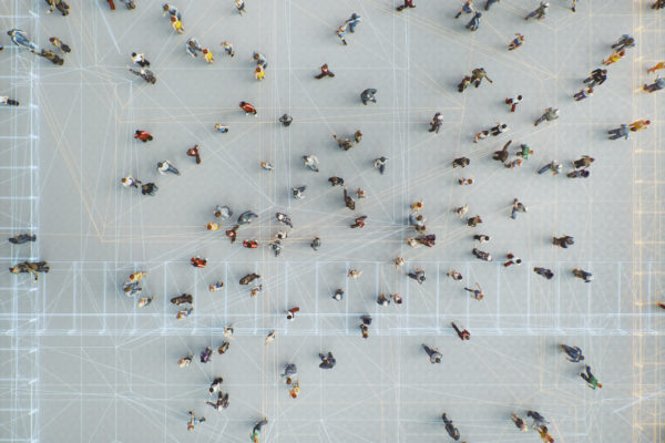 Aerial photo of a crowd with data grids projected on ground.