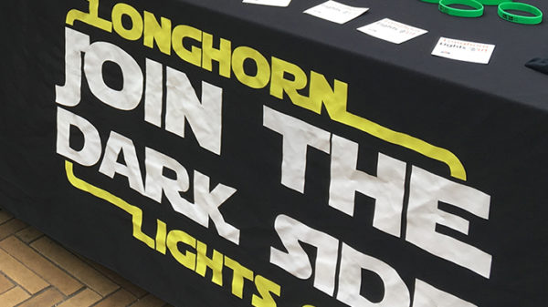 A photo of a Longhorn Lights Out sign.