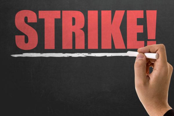 Strike written on a chalkboard