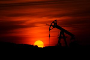 sunrise in an oil field