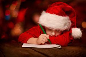 Christmas child writing letter to Santa