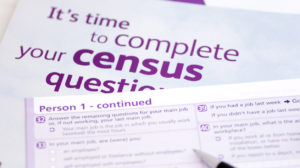 Pen over purple and white census forms