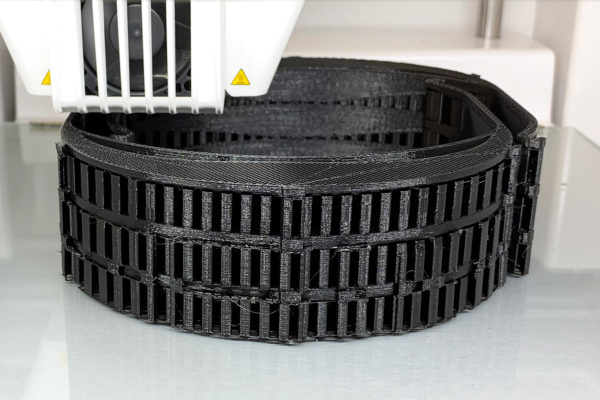 A black cylinder with holes around it