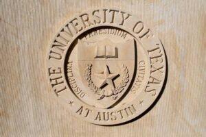 seal, university, limestone, texas union, wall