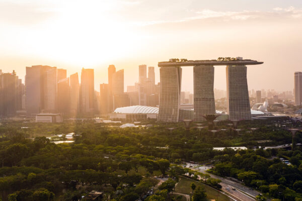 a view of the cityscape of singapore at sunset