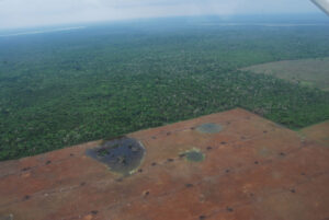 Aerial shot showing deforestation in Belize. Photo by Tim Beach, UT Austin (2012).