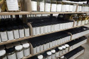 Specimen jars line several rows of shelves.