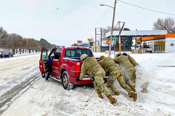 Texas Guardsmen assist a motorist stuck on snow