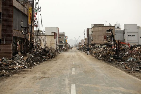 Ruined buildings on either side of a road in central Japan
